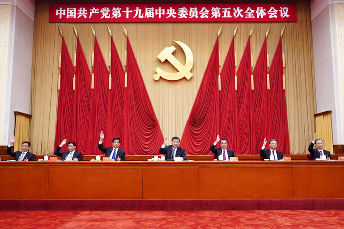 In this photo released by Xinhua News Agency, Chinese President Xi Jinping, also general secretary of the Communist Party of China (CPC) Central Committee, leads other Chinese leaders attending the fifth plenary session of the 19th Central Committee of the Communist Party of China (CPC) in Beijing, China on Oct. 29, 2020. China's leaders are vowing to make their country a self-reliant