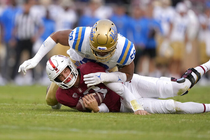 Stanford quarterback Tanner McKee (18) is sacked by UCLA defensive lineman Datona Jackson (58) during the second half of an NCAA college football game Saturday, Sept. 25, 2021, in Stanford, Calif. UCLA won 35-24. (AP Photo/Tony Avelar)
