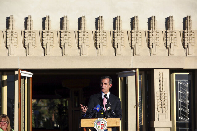 FILE - In this Feb. 13, 2015 photo, Los Angeles Mayor Eric Garcetti speaks at the reopening ceremony of the newly restored Hollyhock House designed by architect Frank Lloyd Wright in the Hollywood district of Los Angeles. The house, which was almost demolished in the 1940s, earned Los Angeles its first World Heritage designation in July 2020. (AP Photo/Richard Vogel, File)