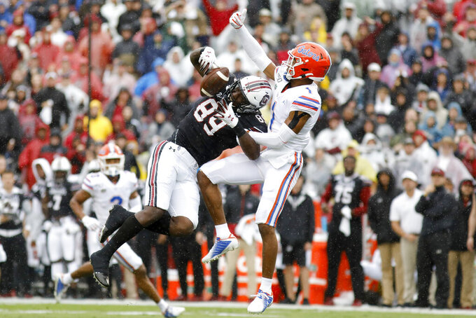 South Carolina's Bryan Edwards (89) catches a pass as Florida's CJ Henderson (1) defends in the first half of an NCAA college football game Saturday, Oct. 19, 2019, in Columbia, SC. (AP Photo/Mic Smith)