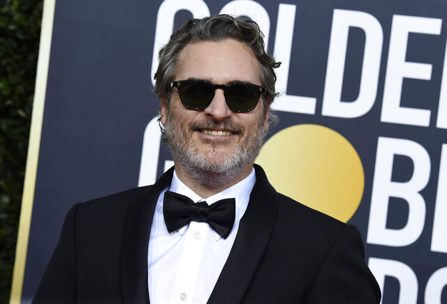 "FILE - In this Sunday, Jan. 5, 2020 file photo, Joaquin Phoenix arrives at the 77th annual Golden Globe Awards at the Beverly Hilton Hotel on  in Beverly Hills, Calif. The film ""Joker"" has topped the nominations for the British Academy film awards announced on Tuesday Jan. 7, 2020. The awards will be announced at a gala event hosted by Graham Norton on February 2. (Photo by Jordan Strauss/Invision/AP, File)"