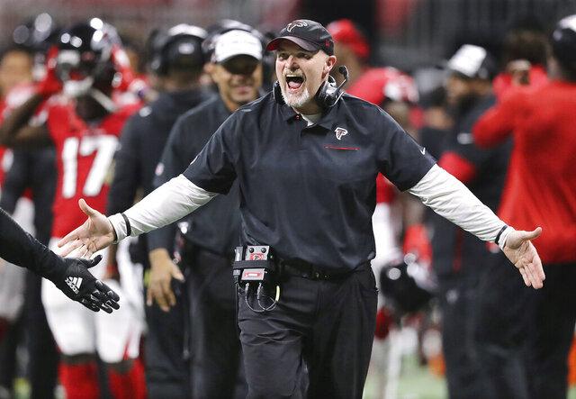 Atlanta Falcons head coach Dan Quinn speaks to players during the first half of an NFL football game against the Jacksonville Jaguars, Sunday, Dec. 22, 2019, in Atlanta. (Curtis Compton/Atlanta Journal-Constitution via AP)