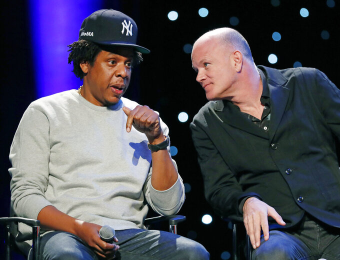"Entrepreneur and business mogul Shawn ""Jay-Z"" Carter left, speaks to Michael Novogratz, founder and CEO of Galaxy Digital, during the launch of REFORM Alliance, a partnership among entertainment moguls, recording artists, business and sports leaders who hope to transform the American criminal justice system, Wednesday, Jan. 23, 2019, in New York. The group is led by Van Jones, a CNN host, activist and former adviser to President Barack Obama. (AP Photo/Kathy Willens)"