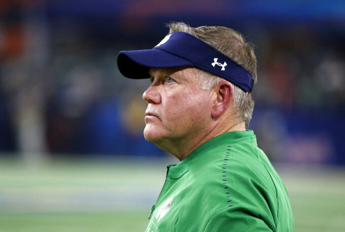 Notre Dame head coach Brian Kelly watches play against Clemson late in the first half of the NCAA Cotton Bowl semi-final playoff football game, Saturday, Dec. 29, 2018, in Arlington, Texas. (AP Photo/Michael Ainsworth)