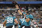 Jacksonville Jaguars quarterback Gardner Minshew, front right, throws a pass against the Cleveland Browns during the first half of an NFL preseason football game, Saturday, Aug. 14, 2021, in Jacksonville, Fla. (AP Photo/Phelan M. Ebenhack)