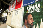 Banners of Spain's far-right Vox party candidate Santiago Abascal, right, and Spain's caretaker Prime Minister and socialist candidate Pedro Sanchez are displayed in Torre-Pacheco, Spain, Monday, Nov. 11, 2019. The farming town of Torre-Pacheco, heavily reliant on foreign workers, voted in droves for Vox, which has vowed to build walls to contain migrants and prioritize the needs of Spaniards. (AP Photo/Sergio Rodrigo)