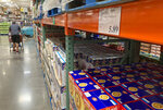 A shopper guides a cart past a line of gigantic boxes of breakfast cereals in a Costco warehouse on Thursday, June 17, 2021, in Lone Tree, Colo. Inflation at the wholesale level jumped 1% in June, pushing price gains over the past 12 months up by a record 7.3%. The Labor Department reported Wednesday, July 14 that the June increase in its producer price index, which measures inflation pressures before they reach consumers, followed a gain of 0.8% in May and was the largest one-month increase since January.  (AP Photo/David Zalubowski)