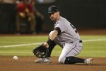 Miami Marlins third baseman Jon Berti gets set to scoop a grounder hit by Arizona Diamondbacks' Nick Ahmed before throwing to first base for the out during the fourth inning of a baseball game, Monday, Sept. 16, 2019, in Phoenix. (AP Photo/Ross D. Franklin)
