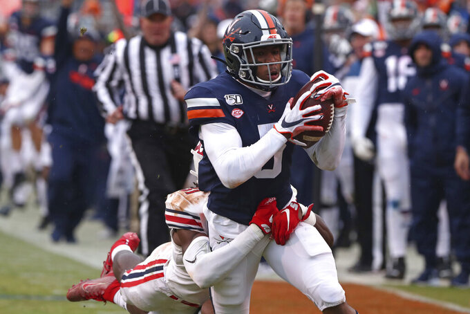 Virginia's Lamont Atkins (5) scores a touchdown against Liberty during an NCAA college football game Saturday, Nov. 23, 2019, in Charlottesville, Va. (Erin Edgerton/The Daily Progress via AP)