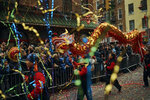 Members of a dragon dance group carry the dragon during the Chinese Lunar New Year parade in Chinatown in New York, Sunday, Feb. 17, 2019. (AP Photo/Andres Kudacki)