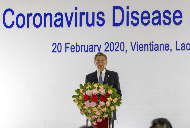 FILE - In this Feb. 20, 2020, file photo, China's Foreign Minister Wang Yi speaks during a joint press conference of the Co-Chairs Special ASEAN-China Foreign Ministers' meeting on the Novel Coronavirus Pneumonia in Vientiane, Laos. The United States has postponed a meeting of leaders of southeast Asian nations that was set for Las Vegas in mid-March due to the spread of the coronavirus. (AP Photo/Sakchai Lalit, File)