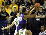 Kansas State forward Xavier Sneed, top right, pulls in a rebound over Baylor guard Matthew Mayer, left, in the second half of an NCAA college basketball game, Saturday, Feb. 9, 2019, in Waco, Texas. (Rod Aydelotte/Waco Tribune Herald, via AP)
