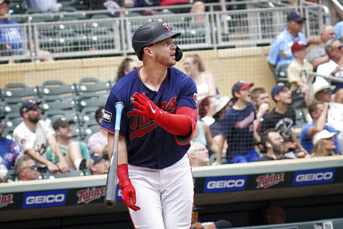 Minnesota Twins' Ryan Jeffers (27) watches his grand slam in the fourth inning of a baseball game against Detroit Tigers, Wednesday, July 28, 2021, in Minneapolis. (Glen Stubbe/Star Tribune via AP)