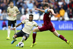 Manchester United's Fred, left, slides in on West Ham United's Declan Rice during the English Premier League soccer match at London Stadium, Sunday Sept. 22, 2019. (Nigel French/PA via AP)