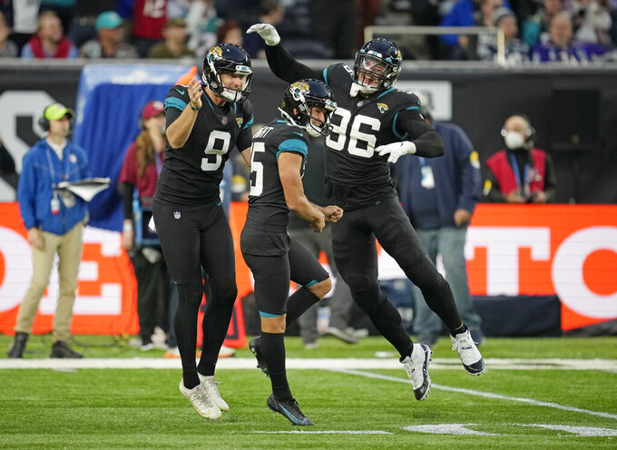 Jacksonville Jaguars kicker Matthew Wright (15), center, celebrates after kicking a field goal to win the match during the second half of an NFL football game between the Miami Dolphins and the Jacksonville Jaguars at the Tottenham Hotspur stadium in London, England, Sunday, Oct. 17, 2021. (AP Photo/Matt Dunhan)