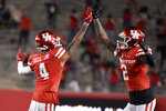 Houston wide receiver Nathaniel Dell (4) celebrates his touchdown with Deontay Anderson during the first half of an NCAA college football game against BYU, Friday, Oct. 16, 2020, in Houston. (AP Photo/Eric Christian Smith)