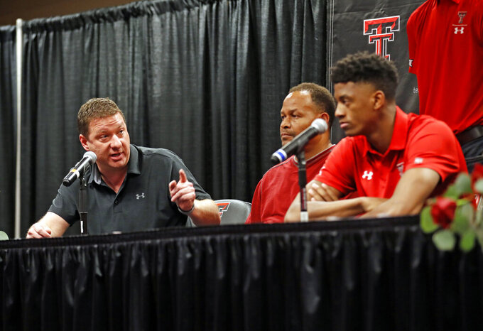 Texas Tech coach Chris Beard, left, talks about Jarrett Culver, right, who declared to enter the NBA basketball draft during a news conference, Thursday, April 18, 2019, in Lubbock, Texas. (Brad Tollefson/Lubbock Avalanche-Journal via AP)
