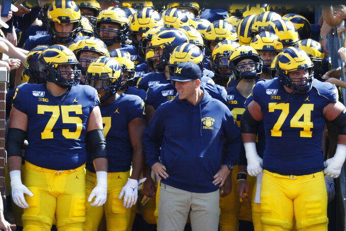 FILE - Michigan head coach Jim Harbaugh waits to lead the team on the field before an NCAA college football game against Army in Ann Arbor, Mich., in this Saturday, Sept. 7, 2019, file photo. Jim Harbaugh and the Michigan Wolverines are looking forward to a fresh start, opening against Western Michigan at home, after a two-win, pandemic-shortened season.(AP Photo/Paul Sancya, File)