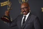 """Courtney B. Vance poses with the award for outstanding guest actor in a drama series for """"Lovecraft Country"""" on night two of the Creative Arts Emmy Awards on Sunday, Sept. 12, 2021, in Los Angeles. (Photo by Richard Shotwell/Invision/AP)"""