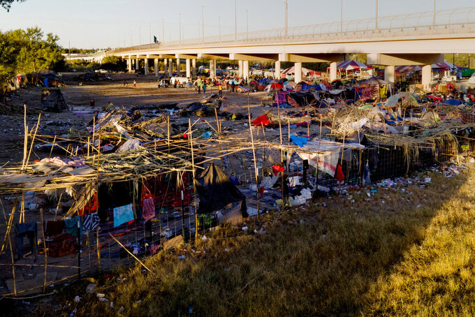 Migrants, many from Haiti, are seen in an encampment near the Del Rio International Bridge, Friday, Sept. 24, 2021, in Del Rio, Texas. (AP Photo/Julio Cortez)
