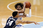 Duke guard Jordan Goldwire (14) defends against North Carolina guard R.J. Davis (4) during the first half of an NCAA college basketball game in Chapel Hill, N.C., Saturday, March 6, 2021. (AP Photo/Gerry Broome)