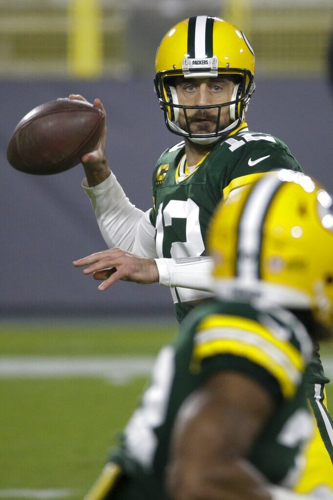 Green Bay Packers' Aaron Rodgers looks to pass during the first half of an NFL football game against the Carolina Panthers Saturday, Dec. 19, 2020, in Green Bay, Wis. (AP Photo/Mike Roemer)