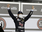 William Byron celebrates in Victory Lane after winning the NASCAR Cup Series auto race at Daytona International Speedway, Saturday, Aug. 29, 2020, in Daytona Beach, Fla. (AP Photo/Terry Renna)