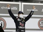 William Byron celebrates in Victory Lane after winning the NASCAR Cup Series auto race at Daytona International Speedway, Saturday, Aug. 29, 2020, in Daytona Beach, Fla. (AP Photo/Terry Renna)