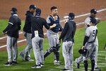 New York Yankees catcher Gary Sánchez, center, and teammates celebrate a 7-2 win over the Toronto Blue Jays in a baseball game in Buffalo, N.Y., Wednesday, Sept. 9, 2020. (AP Photo/Adrian Kraus)