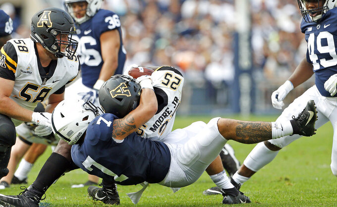 Penn State's Koa Farmer (7) takes down Appalachian State's Jalin Moore Jr. (25) during the first half of an NCAA college football game in State College, Pa., Saturday, Sept. 1, 2018. (AP Photo/Chris Knight)