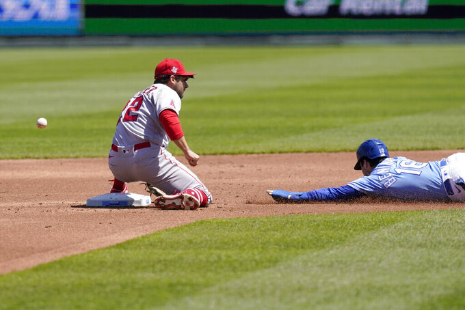 Kansas City Royals Andrew Benintendi (16) steals second base as the ball gets past Los Angeles Angels second baseman David Fletcher (22) during the first inning of a baseball game at Kauffman Stadium in Kansas City, Mo., Wednesday, April 14, 2021. Benintendi advanced to third base on the play. (AP Photo/Orlin Wagner)