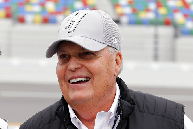 FILE - In this Feb. 10, 2019, file photo, NASCAR team owner Rick Hendrick laughs on pit road during qualifying for the Daytona 500 auto race at Daytona International Speedway, in Daytona Beach, Fla. Win the Coca-Cola 600 in Charlotte and Hendrick Motorsports would bump Richard Petty Enterprises for the most team wins in Cup Series history. (AP Photo/Terry Renna, File)
