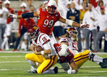 Utah defensive tackle Hauati Pututau (41) sacks Southern California quarterback JT Daniels (18) during the first half of an NCAA college football game Saturday, Oct. 20, 2018, in Salt Lake City. (AP Photo/Rick Bowmer)