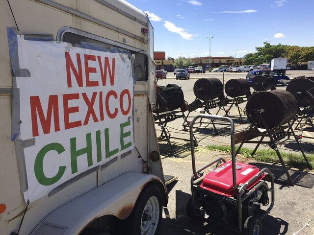 FILE - In this Aug. 11, 2016, file photo, green chile from Hatch, N. M., goes on sale at a roadside roasting stand in Santa Fe, N.M. Organizers of the annual Hatch Chile Festival said Monday, July 6, 2020, that COVID-19 had forced the cancellation of the event for the first time in its 49-year-old history. (AP Photo/Morgan Lee,File)