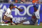 Los Angeles Dodgers' Cody Bellinger, right, slides into second base with a double as San Francisco Giants' Mauricio Dubon fields the ball in the fourth inning of a baseball game Saturday, Sept 28, 2019, in San Francisco. (AP Photo/Ben Margot)