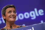 European Competition Commissioner Margrethe Vestager speaks during a media conference at EU headquarters in Brussels, Wednesday, March 20, 2019. European Union regulators have hit Google with a 1.49 billion euro ($1.68 billion) fine for abusing its dominant role in online advertising. (AP Photo/Francisco Seco)