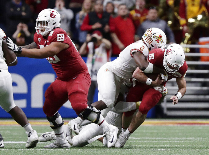 Washington State quarterback Gardner Minshew (16) is sacked by Iowa State linebacker Willie Harvey (2) during the the first half of the Alamo Bowl NCAA college football game Friday, Dec. 28, 2018, in San Antonio. (AP Photo/Eric Gay)