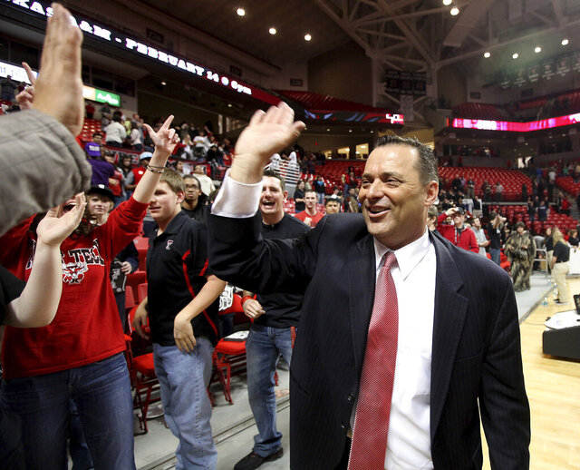FILE - In this Feb. 11, 2012, file photo, Texas Tech coach Billy Gillispie celebrates with fans after defeating Oklahoma in an NCAA college basketball game in Lubbock, Texas. Gillispie was named head coach at Tarleton State, taking over a program making the transition from NCAA Division II to Division I. The move Monday, March 30, 3030, came two years after Gillispie had a successful kidney transplant, and eight years after his last Division I job. (Zach Long/Lubbock Avalanche-Journal via AP, File)