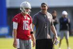 Detroit Lions head coach Dan Campbell talks with quarterback Jared Goff (16) during an NFL football training camp practice in Allen Park, Mich., Saturday, July 31, 2021. (AP Photo/Paul Sancya)
