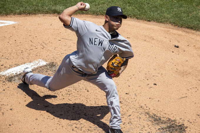 New York Yankees starting pitcher Jonathan Loaisiga throws during the third inning of a baseball game against the Washington Nationals at Nationals Park, Sunday, July 26, 2020, in Washington. (AP Photo/Alex Brandon)