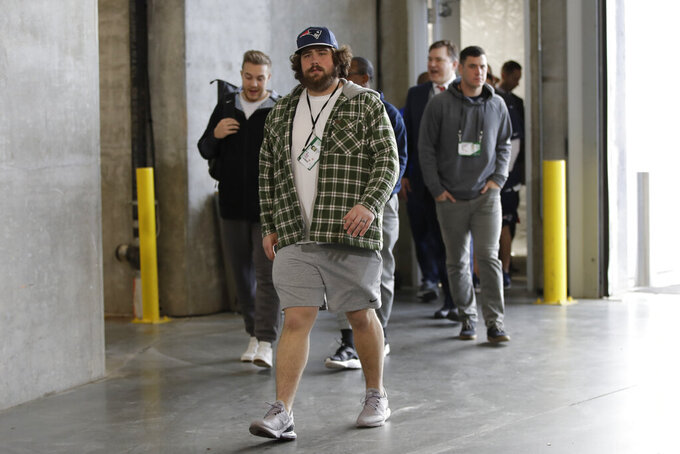 New England Patriots' David Andrews arrives for a NFL football walkthrough, Saturday, Feb. 2, 2019, in Atlanta, ahead of Super Bowl 53 against the Los Angeles Rams. (AP Photo/Matt Rourke)