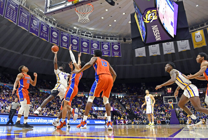 LSU forward Naz Reid (0) shoots over Florida guard Andrew Nembhard (2) during the first half of an NCAA college basketball game Wednesday, Feb. 20, 2019, in Baton Rouge, La. (AP Photo/Bill Feig)