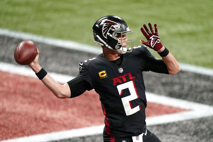Atlanta Falcons quarterback Matt Ryan (2) warms up before the first half of an NFL football game between the Atlanta Falcons and the Las Vegas Raiders, Sunday, Nov. 29, 2020, in Atlanta. (AP Photo/Brynn Anderson)