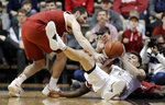 Vanderbilt forward Yanni Wetzell, right, tries the pass the ball away as he battles Alabama guard Riley Norris, left, for control in the first half of an NCAA college basketball game, Saturday, Feb. 9, 2019, in Nashville, Tenn. (AP Photo/Mark Humphrey)