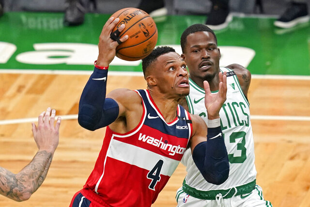 Washington Wizards guard Russell Westbrook (4) drives against Boston Celtics guard Javonte Green during the first quarter of an NBA basketball game Friday, Jan. 8, 2021, in Boston. (AP Photo/Elise Amendola)