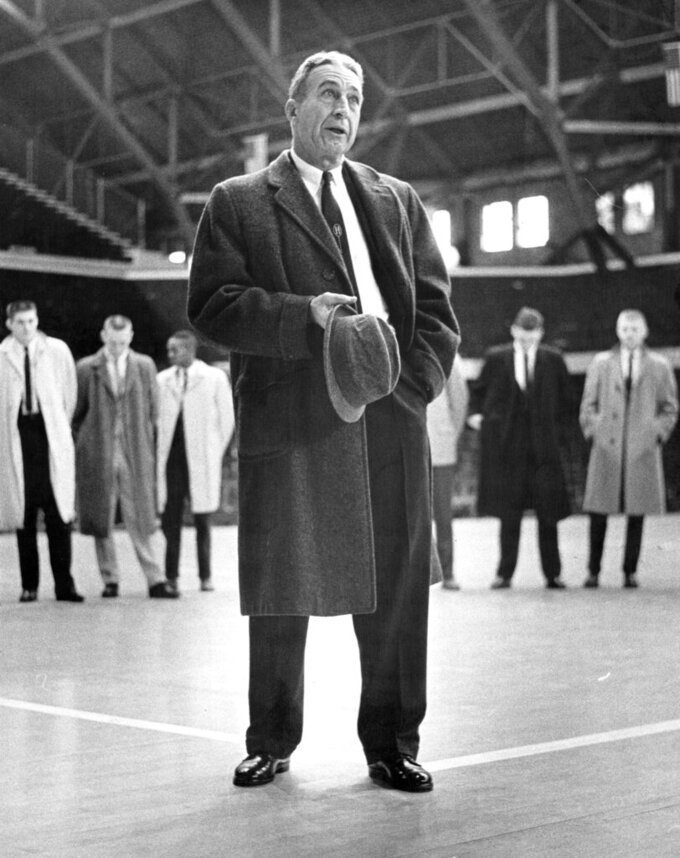 This is a 1962 photo showing Tony Hinkle. Tony Hinkle turned Butler's pass-and-cut offense of the 1920s into a coaching textbook for generations. Bob Knight and Gene Keady added their own revisions following Hinkle's forced retirement in 1970. Today, those three remain the gold standard of basketball innovation in Indiana, a state where successful coaches have spent more than a century testing novel concepts, breaking barriers and polishing philosophies before introducing them America.(Larry George/The Indianapolis Star via AP)