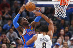 Oklahoma City Thunder center Nerlens Noel, left, is fouled by New Orleans Pelicans center Jahlil Okafor (8) during the second half of an NBA basketball game Friday, Nov. 29, 2019, in Oklahoma City. (AP Photo/Sue Ogrocki)