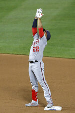 Washington Nationals' Juan Soto reacts after hitting an RBI-double during the fifth inning of a baseball game against the New York Mets, Monday, Aug. 10, 2020, in New York. (AP Photo/Kathy Willens)