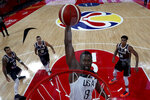 United States' Harrison Barnes dunks during a phase two match against Greece for the FIBA Basketball World Cup at the Shenzhen Bay Sports Center in Shenzhen in southern China's Guangdong province on Saturday, Sept. 7, 2019. United States beats Greece 69-53. (AP Photo/Ng Han Guan, Pool)