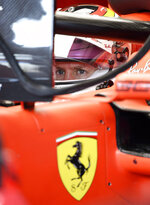 Ferrari driver Sebastian Vettel of Germany sits on his car during the third Formula One practice session at the Hockenheimring racetrack in Hockenheim, Germany, Saturday, July 27, 2019. The German Formula One Grand Prix will be held on Sunday. (AP Photo/Jens Meyer)